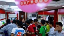 Qatar's Ooredoo opens Myanmar mobile market