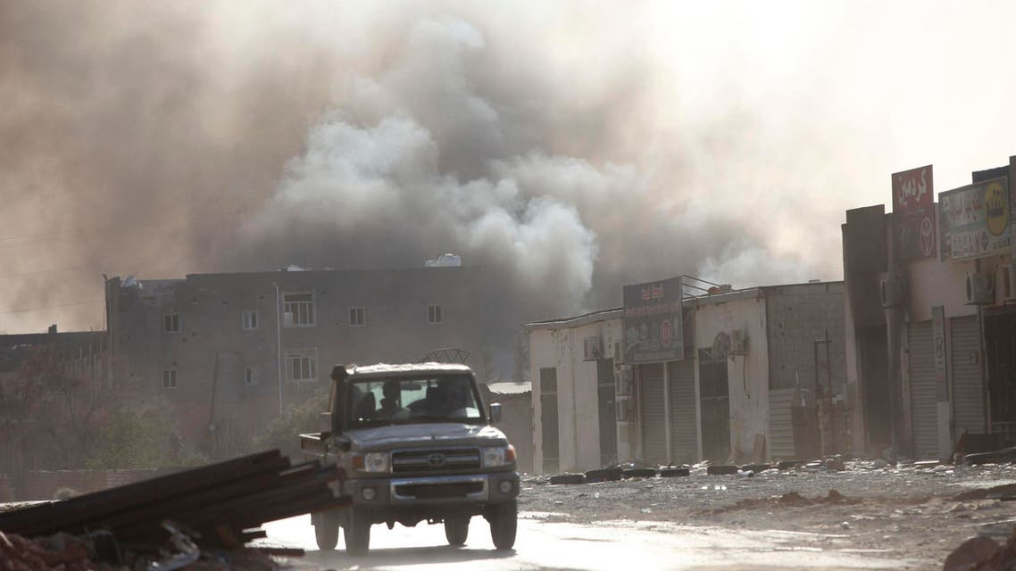 Smoke rises after rockets fired by one of Libya's militias struck and ignited a building after clashes between rival militias, in an area at Alswani road in Tripoli August 2, 2014.