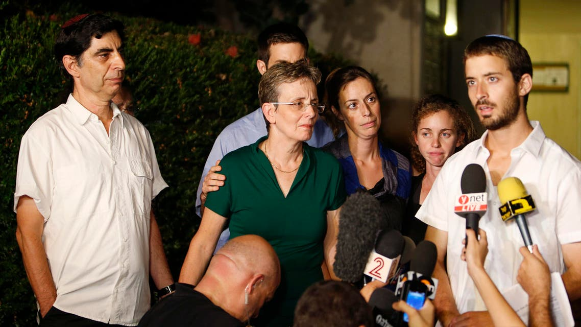 Zur Goldin (R), brother of Israeli soldier Hadar Goldin, and other family members talk to the media outside their home in the central Israeli city of Kfar Saba August 2, 2014