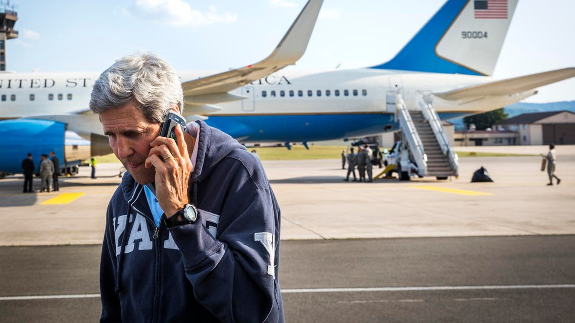 U.S. Secretary of State John Kerry speaks on his phone while his plane refuels at Ramstein Air Base in Ramstein-Miesenbach August 1, 2014.