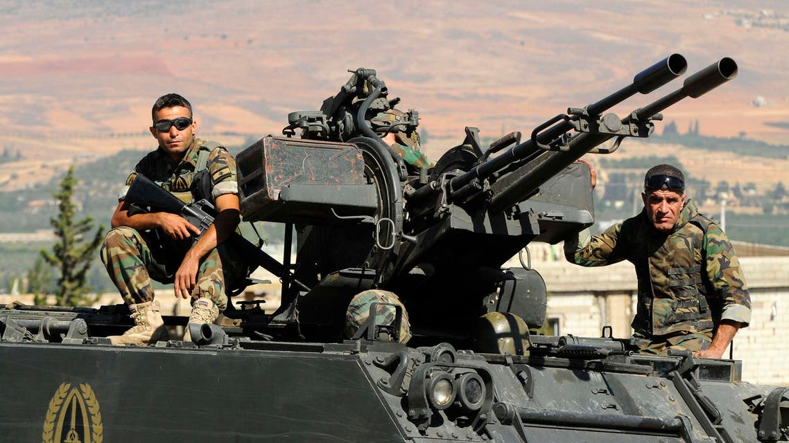 Lebanese army soldiers sit on top of an armoured vehicle near the entrance leading to Arsal August 3, 2014. (Reuters)