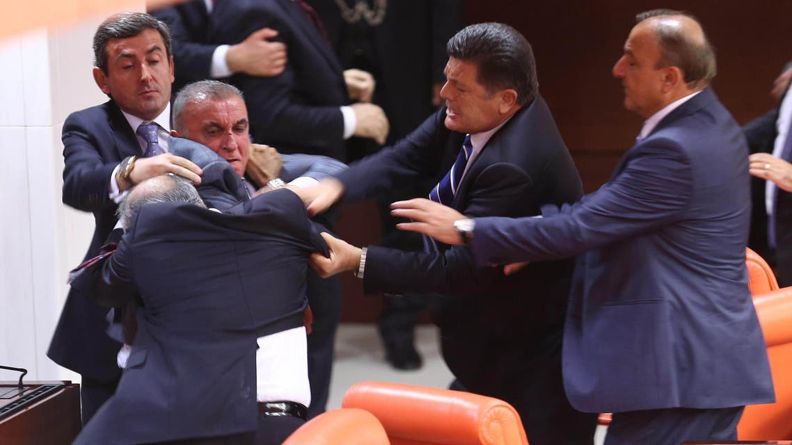 Opposition party MHP's Ali Uzunirmak (3rd L) fights with AKP's Mustafa Sahin (2nd L) at the parliament in Ankara, on August 4, 2014. (AFP)