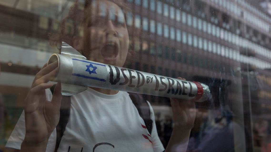 A demonstrator protests in the Department for Business Innovation and Skills building in London July 23, 2014. (Reuters)