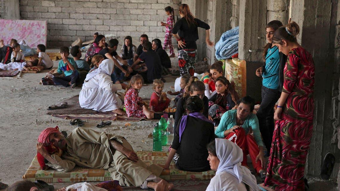 هاربين فارين من منطقة سنجار الواقعة على الحدود العراقية السورية