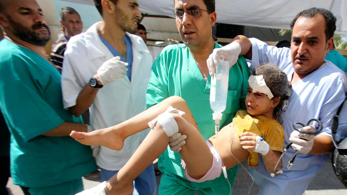 Palestinian medics carry a girl, whom they said was wounded by an Israeli air strike, at a hospital in Rafah in the southern Gaza Strip August 2, 2014. I Reuters