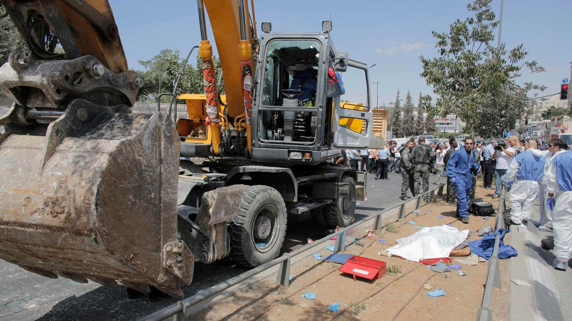 The body of a driver of a construction vehicle lies covered at the scene of a an attack in Jerusalem August 4, 2014. (Reuters)