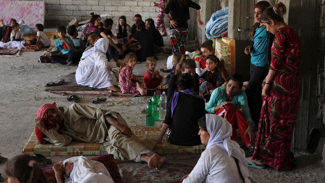 Displaced families from the minority Yazidi sect, fleeing the violence in the Iraqi town of Sinjarl west of Mosul, take refuge at Dohuk province, August 4, 2014. (Reuters)