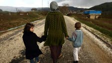 HRW: Women, children held hostage by Syria fighters for year