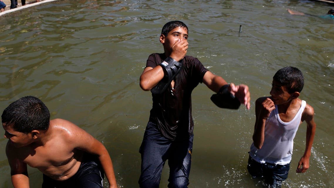 ouths play at a fountain in Gaza City August 7, 2014. (Reuters)