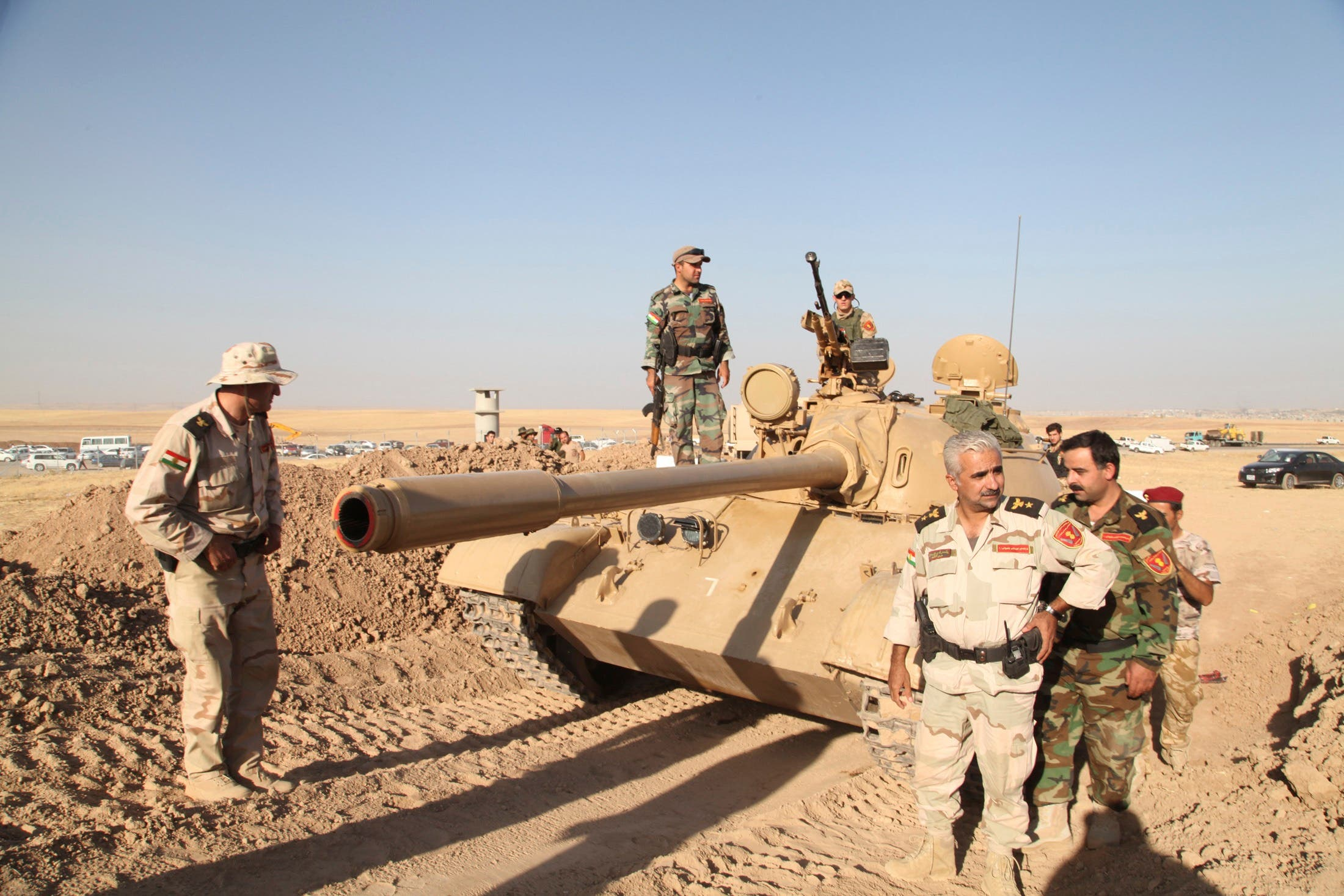 Kurdish peshmerga troops participate in an intensive security deployment against Islamic State militants on the front line in Khazer August 8, 2014.