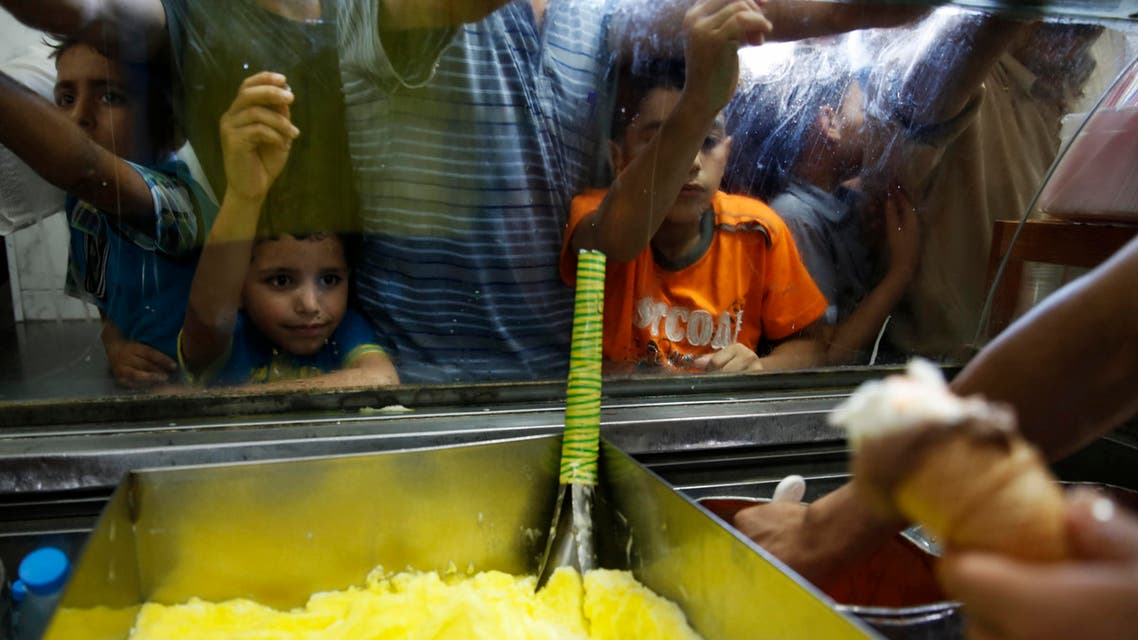 Palestinians crowd into an ice cream shop during the first day of a three day ceasefire, in Gaza City August 5, 2014. (Reuters)
