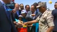 Whoops! Egypt's President Sisi shyly avoids touching woman's hand