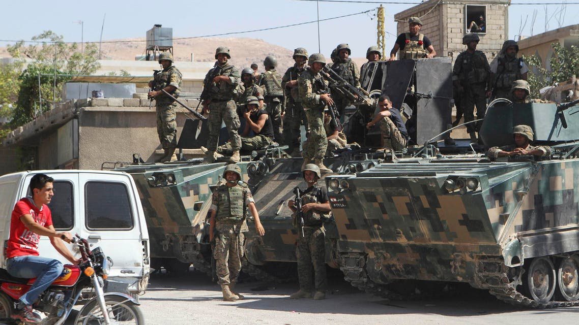 Lebanese Army soldiers are seen on armoured carriers after being deployed inside the Sunni Muslim border town of Arsal, in eastern Bekaa Valley August 9, 2014. (Reuters)