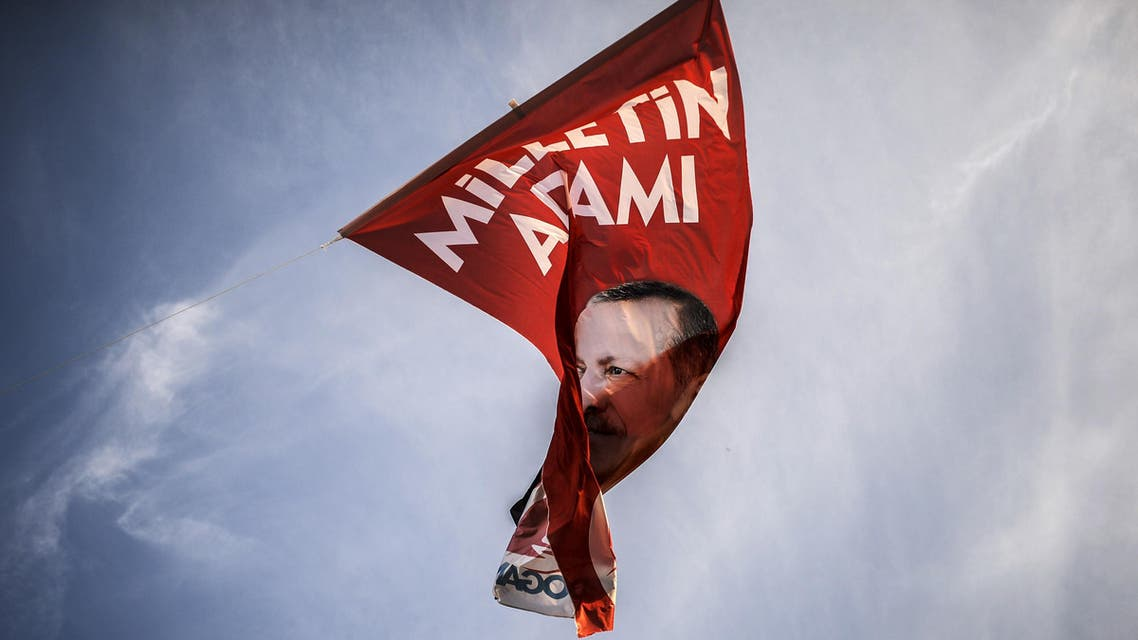A flag depicting Turkish Prime minister Recep Tayyip Erdogan flutters in the air on August 8, 2014, in Istanbul. (AFP) afp