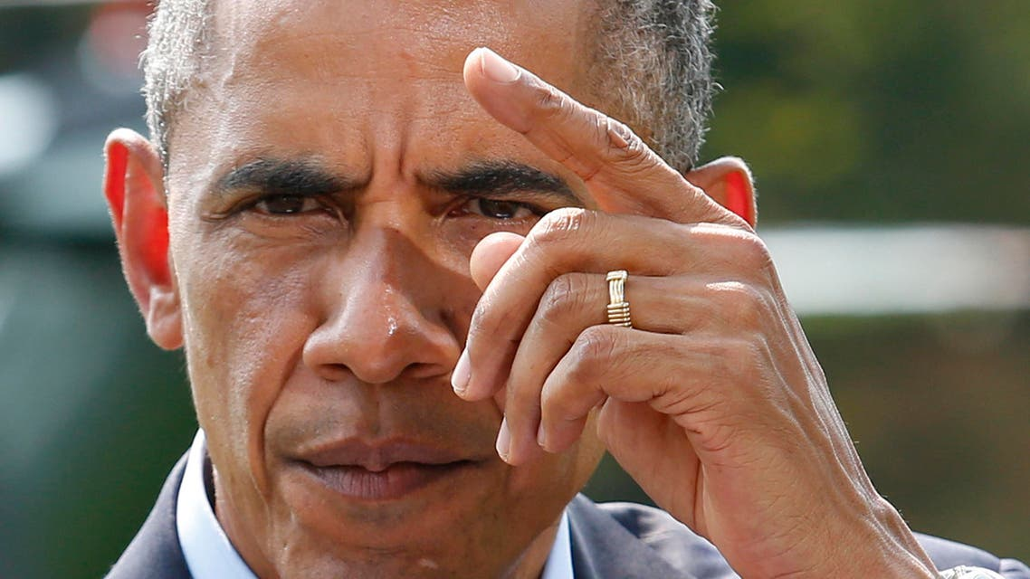 U.S. President Barack Obama gestures as he speaks to the media on the situation in Iraq on the South Lawn of the White House, before his departure for vacation in Martha's Vineyard, in Washington August 9, 2014. (Reuters)