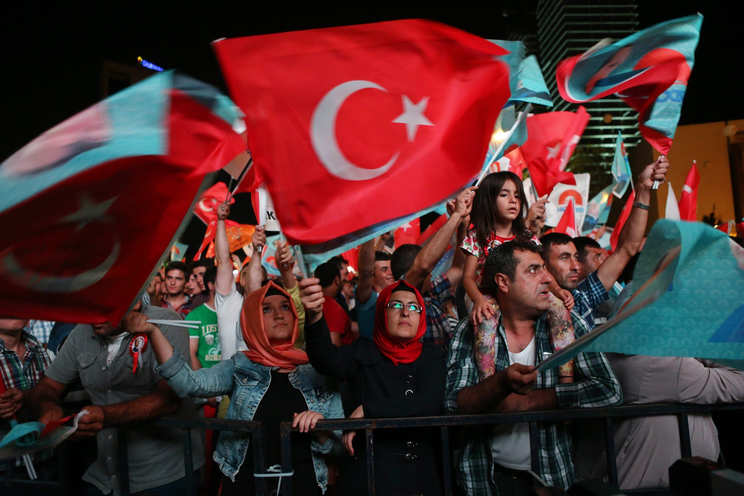 Supporters of Turkey's Prime Minister Recep Tayyip Erdogan celebrate his victory in the presidential election vote in front of the AKP party headquarters in Ankara on August 10, 2014. (AFP)