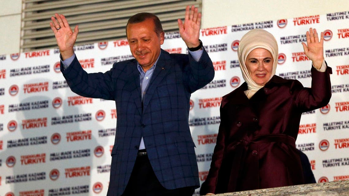 Turkey's Prime Minister Tayyip Erdogan and wife Ermine wave hands to supporters as they celebrate his election victory in front of the party headquarters in Ankara August 10, 2014.  (Reuters)