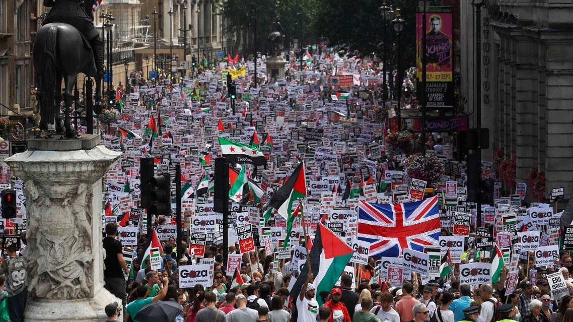 Hundreds of demonstrators march up Whitehall as they protest against Israel's military action in Gaza, in central London July 19, 2014. (Reuters)
