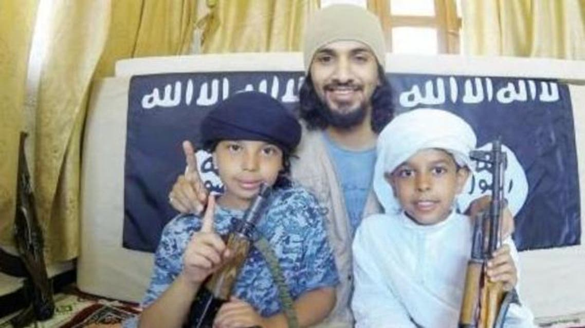 Saudi father posing with kidnapped children in Syria