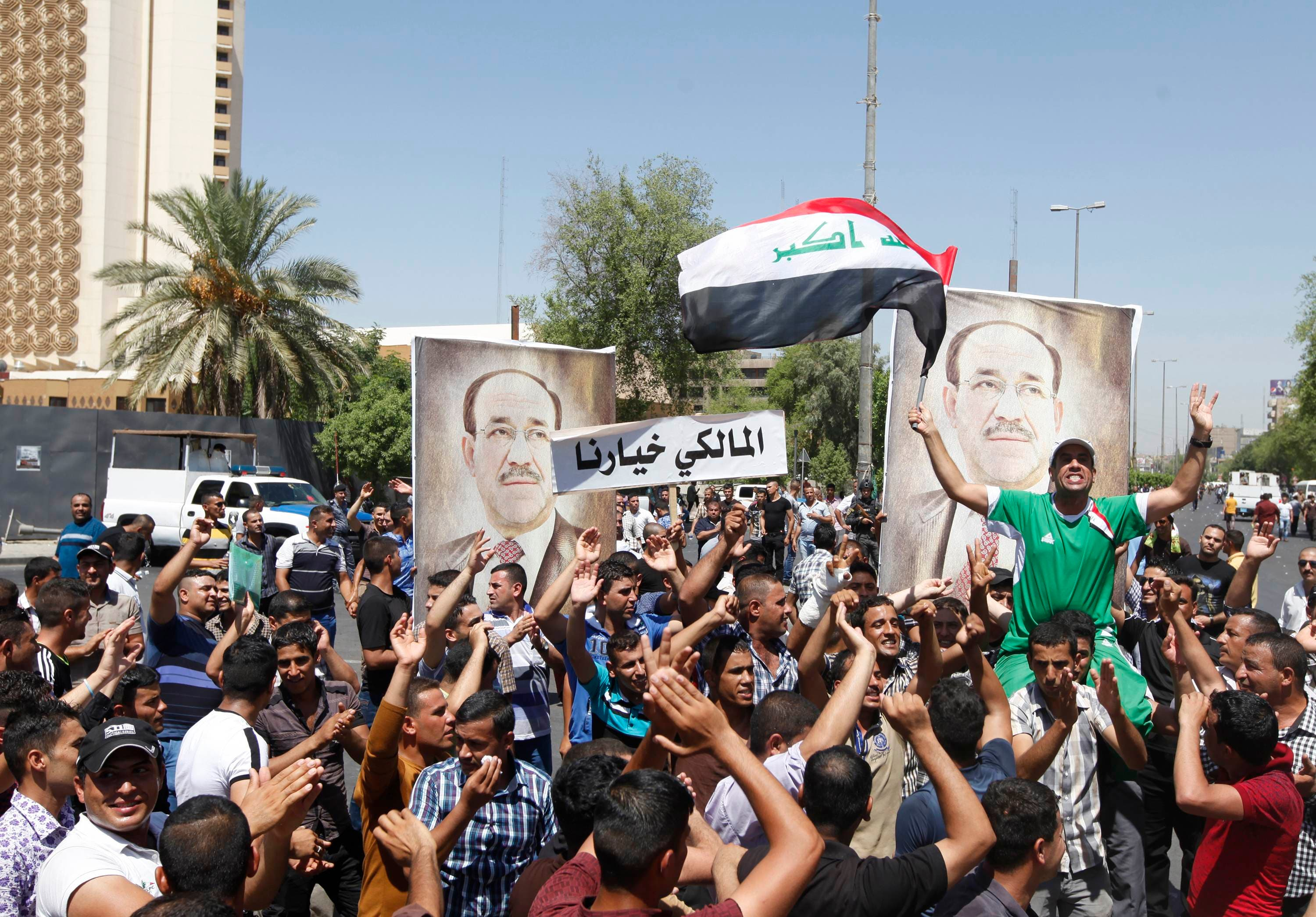 People with portraits of Iraqi Prime Minister Nouri al-Maliki gather at a rally in support of him in Baghdad August 11, 2014. (Reuters)