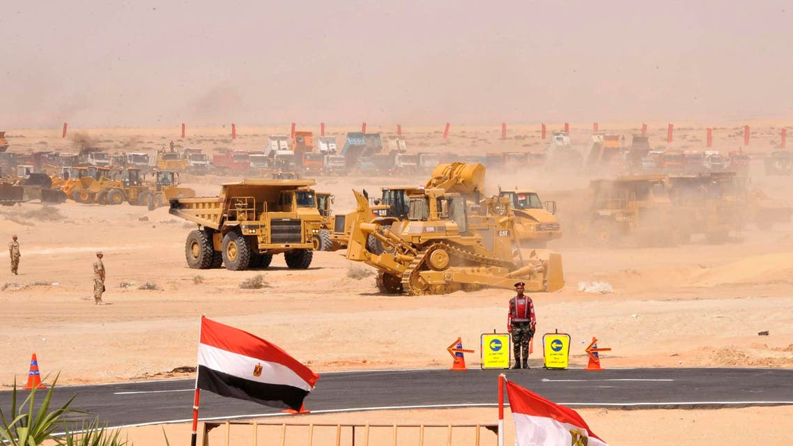 Bulldozers and trucks are seen in a demonstration of the equipment which will be used as part of plans for a major upgrade of the Suez Canal, in Cairo August 5, 2014. (Reuters)