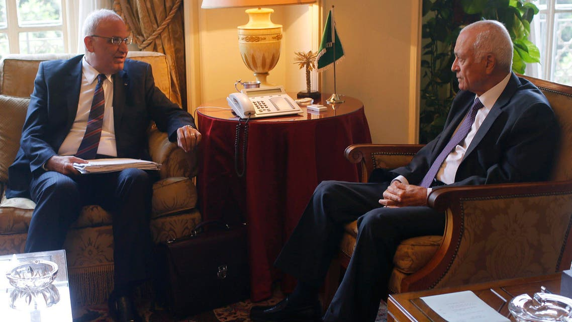 Palestinian chief negotiator Saeb Erekat (L) talks with Arab League Chief Nabil el-Araby during their meeting at the Arab League in Cairo August 11, 2014 reuters