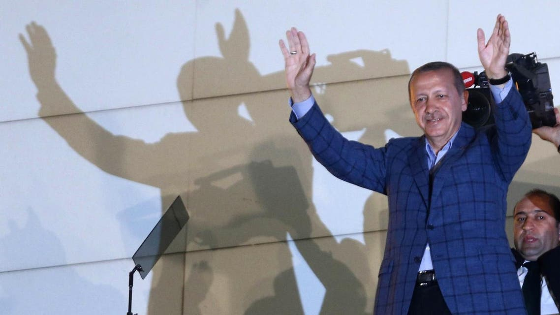 Newly elected Turkish president Recep Tayyip Erdogan waves at supporters from the balcony of the AKP party headquarters during the celebrations of his victory in the presidential election vote in Ankara on August 10, 2014. AFP