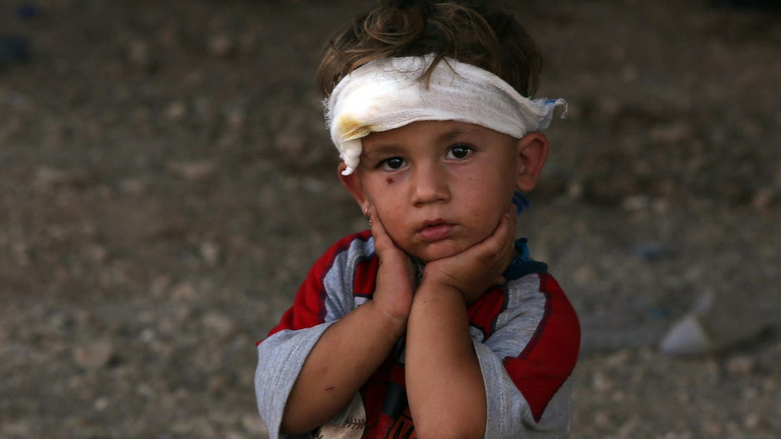 An Iraqi Yazidi child, whose family fled their home a week ago when ISIS militants attacked the town of Sinjar. (AFP)