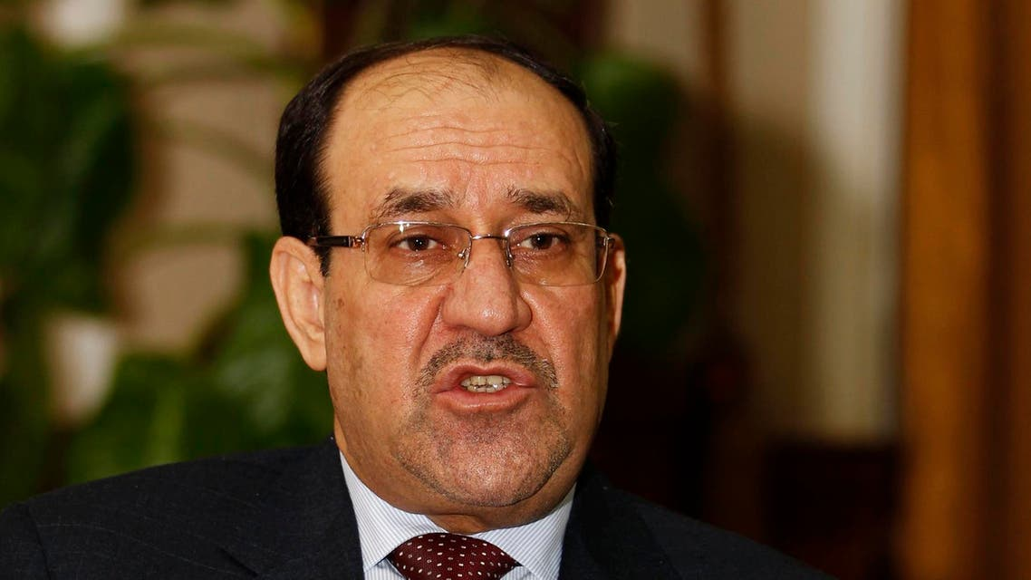 raq's Prime Minister Nuri al-Maliki speaks during an interview with Reuters in Baghdad in this January 12, 2014 file photo