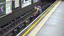 Wind blows child in pram on Tube tracks seconds before train arrives