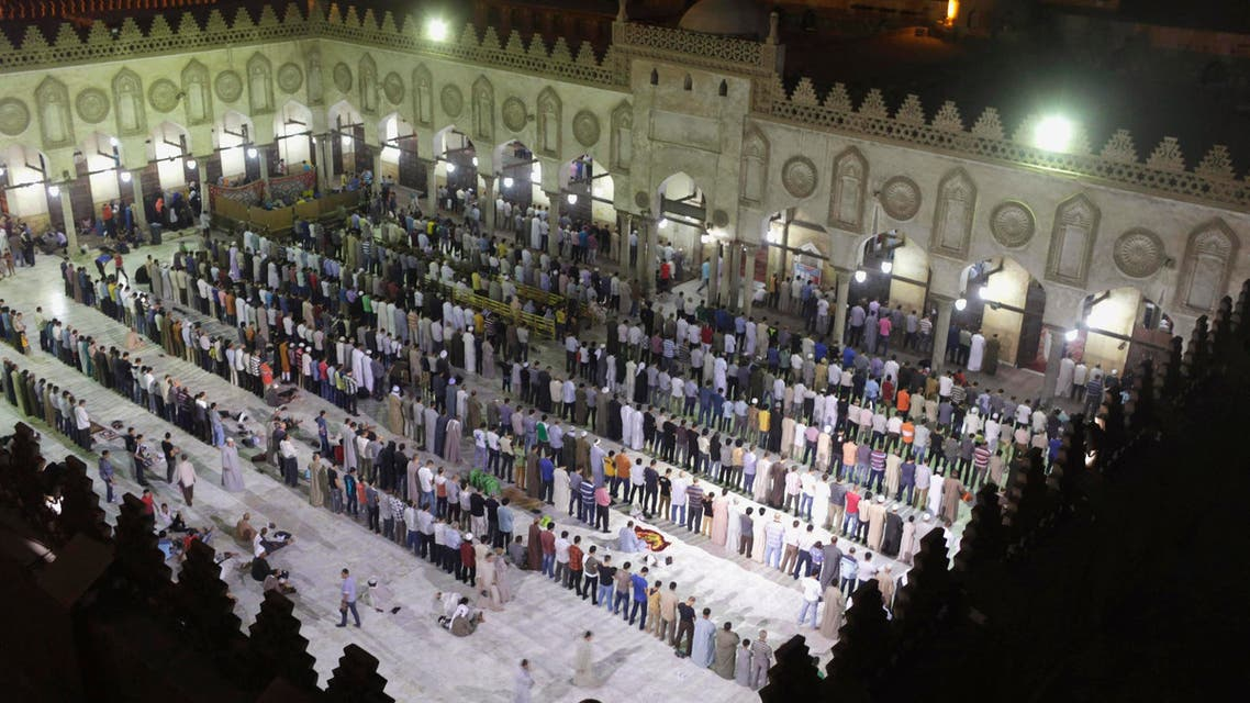 Muslims conduct taraweeh prayers as they gather specially for Lailat al-Qadr, at Al-Azhar Mosque in Cairo July 24, 2014.(Reuters)