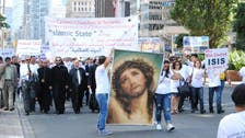 Iraqi Christians protest ISIS atrocities in flag-free, silent Toronto march