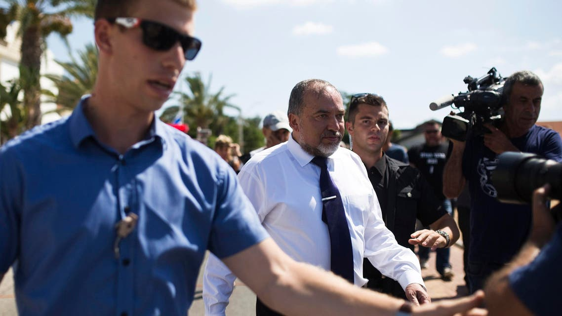 Israel's Foreign Minister Avigdor Lieberman (C) is surrounded by bodyguards during a visit with his Norwegian counterpart Borge Brende (not pictured) to the site where a rocket landed in Ashkelon July 16, 2014. (Reuters)