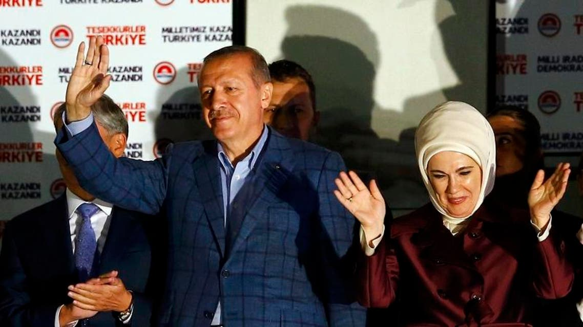 Turkey's Prime Minister Tayyip Erdogan celebrates his election victory next to wife Ermine in front of the party headquarters in Ankara August 10, 2014. reuters