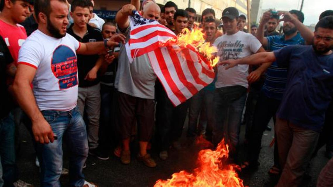 Protesters burn a U.S. flag during a protest against a film they consider blasphemous to Islam and insulting to the Prophet Mohammad in Tripoli, northern Lebanon September 13, 2012. (Reuters)