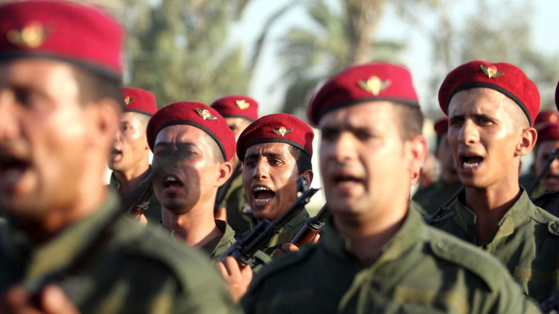 Shi'ite volunteers, from Abbas Unit who have joined the Iraqi army to fight against militants of the Islamic State, formerly known as the Islamic State in Iraq and the Levant (ISIL), parade down a street in Kerbala, southwest of Baghdad August 14, 2014. (Reuters)