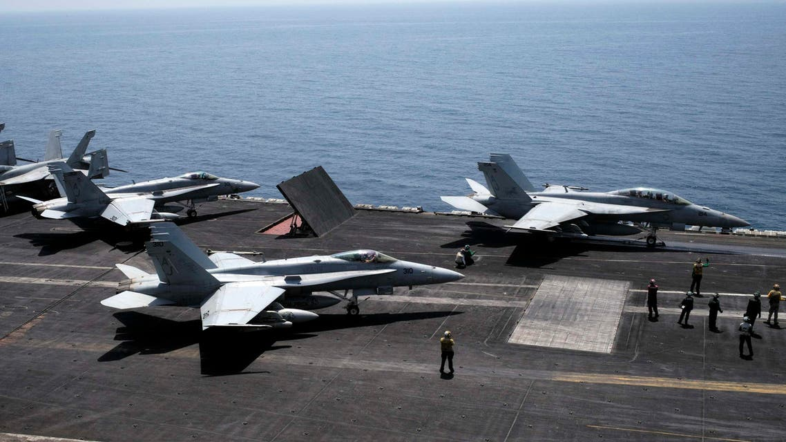 An F/A-18F Super Hornet of Strike Fighter Squadron (VFA-213) (R) and an F/A-18C Hornet of Strike Fighter Squadron (VFA-15) prepare for take off onboard the aircraft carrier USS George H.W. Bush in the Gulf August 13, 2014. (Reuters)