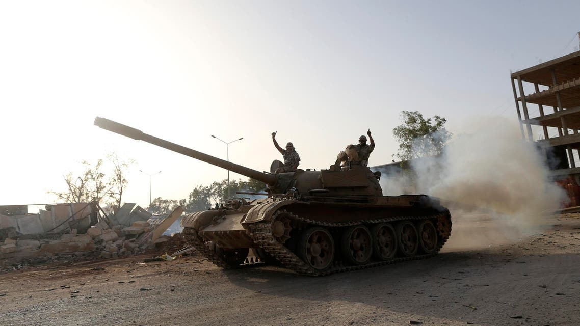 Fighters from the Benghazi Shura Council, which includes former rebels and militants from al Qaeda-linked Ansar al-Sharia, gesture on top of a tank next to the camp of the special forces in Benghazi July 30, 2014. (Reuters)