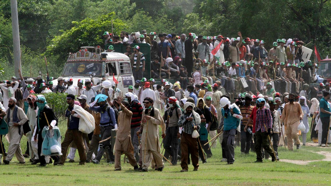 Supporters of Muhammad Tahirul Qadri, Sufi cleric and leader of political party Pakistan Awami Tehreek (PAT) begin their march toward the capital from Lahore August 14, 2014. (Reuters)