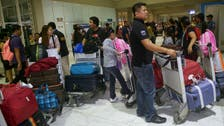 Philippines brings home hundreds more workers from Libya