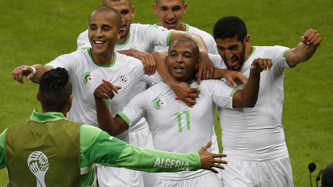 Algeria's national soccer team players celebrate their fourth goal over South Korea during their 2014 World Cup (Reuters)