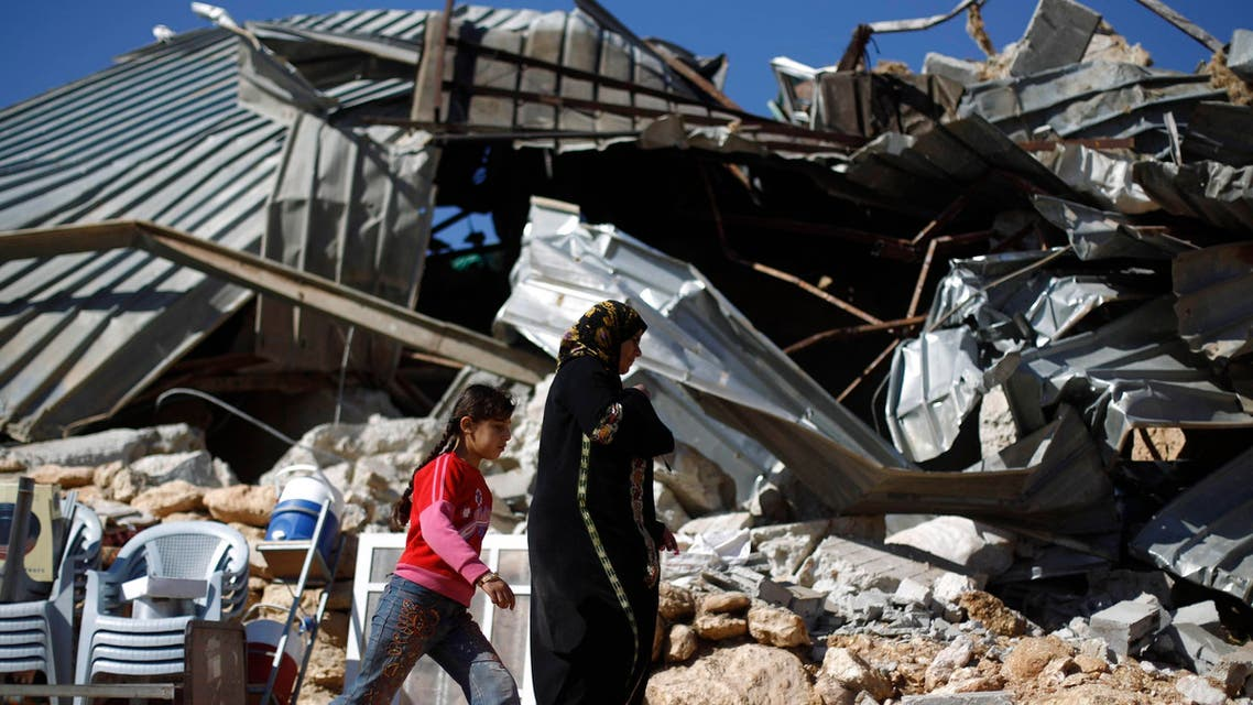 Palestinians walk past a structure after it was demolished by Israeli bulldozers in Khirbet Al-Taweel village near the West Bank City of Nablus April 29, 2014. REUTERS/Mohamad TorokmanPalestinians walk past a structure after it was demolished by Israeli bulldozers in Khirbet Al-Taweel village near the West Bank City of Nablus April 29, 2014. (Reuters)