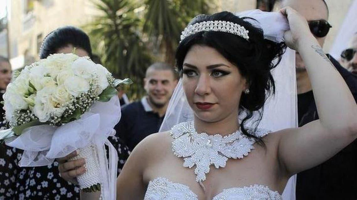 Mahmoud Mansour, and his bride Morel Malka, celebrate. (Reuters)