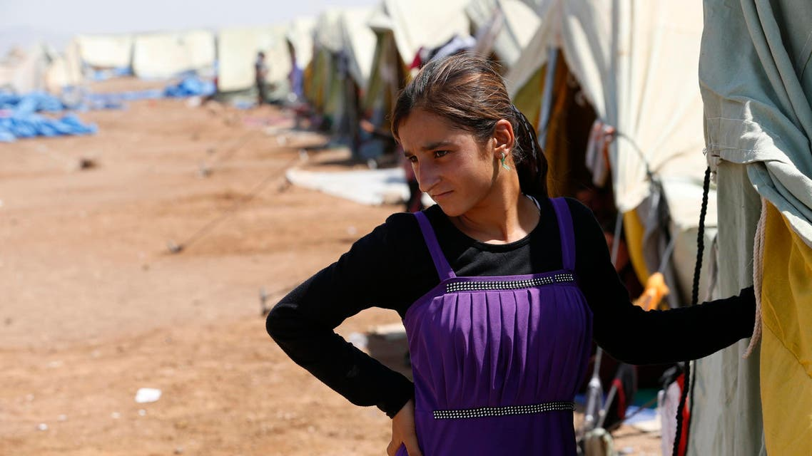 A displaced girl from the minority Yazidi sect, who fled the violence in the Iraqi town of Sinjar, stands at Nowruz refugee camp in Qamishli, northeastern Syria on the border with Kurdistan August 16, 2014. (Reuters)