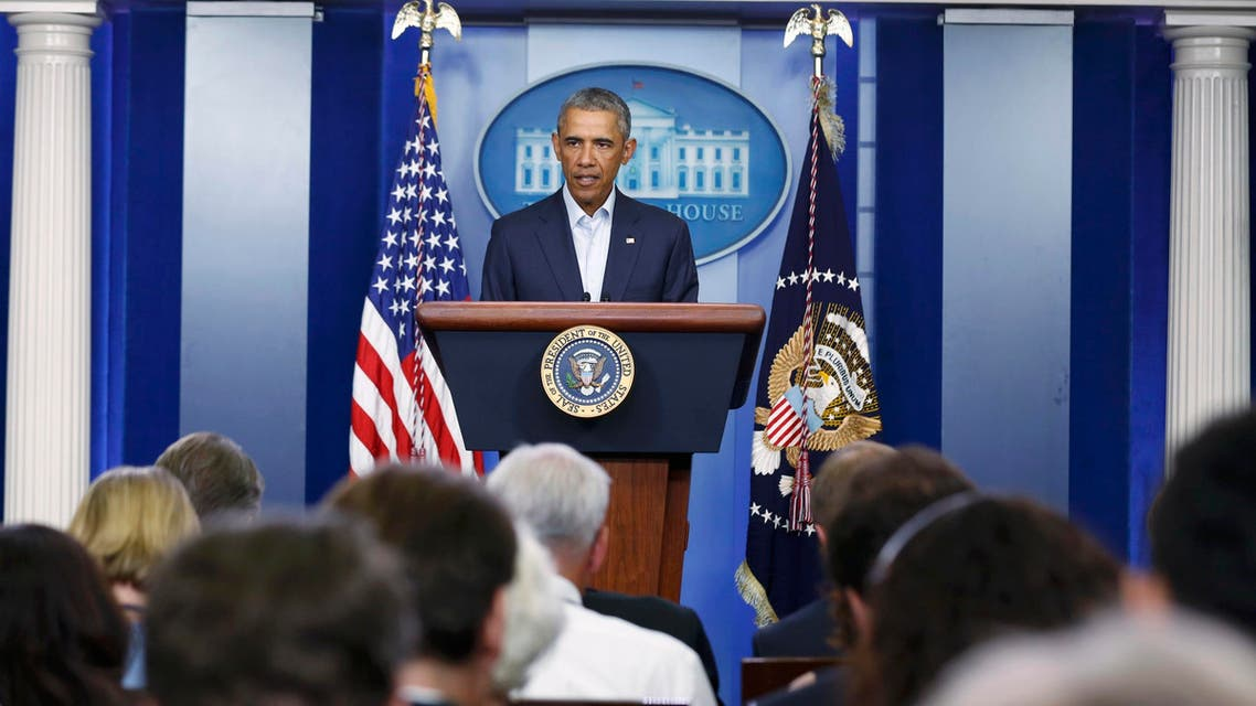 U.S. President Barack Obama addresses reporters about developments in Iraq and civil unrest in Ferguson, Missouri, from the White House in Washington, August 18, 2014.