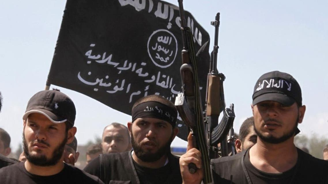 Islamist fighters carry their flag during a funeral outside Aleppo, Syria. (File photo: Reuters)