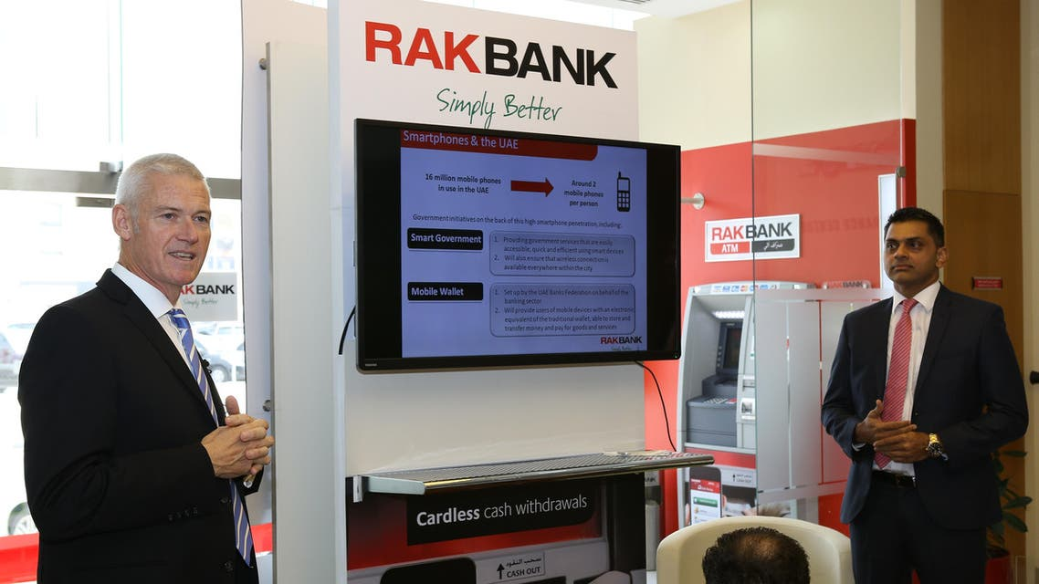 RAKBANK CEO Peter England (L) with with Head of Channels Masood Khan. (Photo courtesy of: RAKBANK)