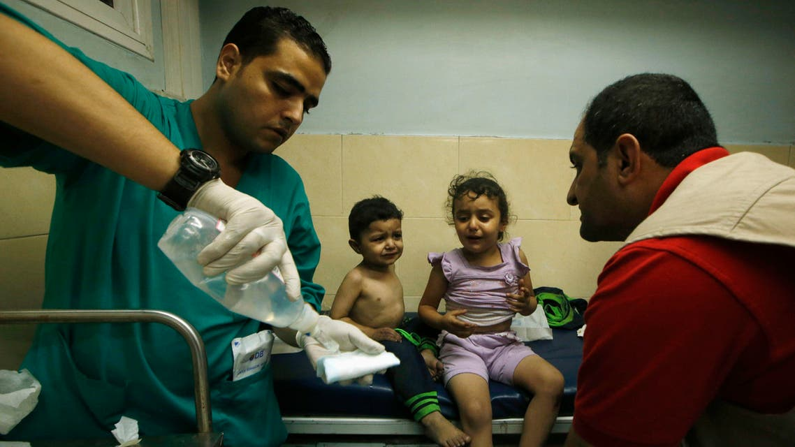 Palestinian children, who hospital officials said were wounded in an Israeli air strike, receive treatment at a hospital in Gaza City August 19, 2014.