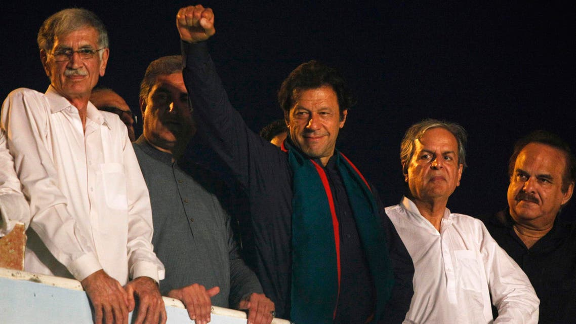 Former international cricketer Imran Khan, chairman of the Pakistan Tehreek-e-Insaf (PTI) political party, gestures to his supporters during a Freedom March to the parliament house in Islamabad August 19, 2014. (Reuters)