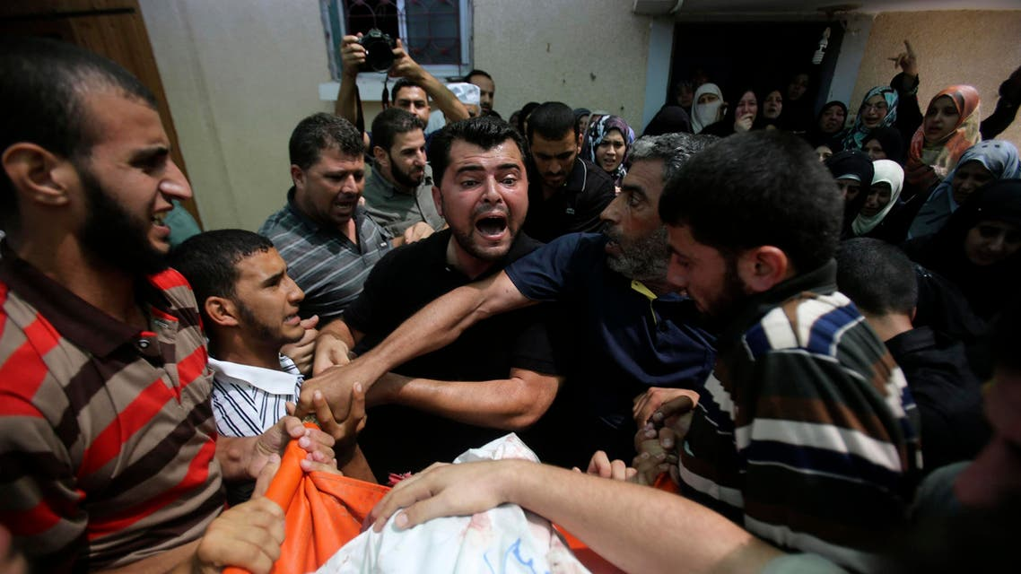A Palestinian reacts next to the body of Mohammed Abu Shammala, one of three senior Hamas commanders who were killed in an Israeli air strike, during his funeral in Rafah in the southern Gaza Strip August 21, 2014.